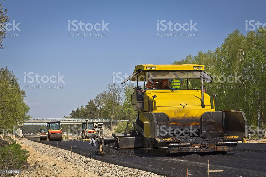 Road construction machines at work stock photo