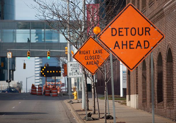 Road construction Signs in  a downtown area stock photo