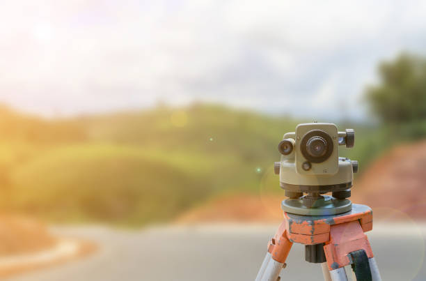 road construction site, theodolite instrument for road construction - civil engineering stock pictures, royalty-free photos & images