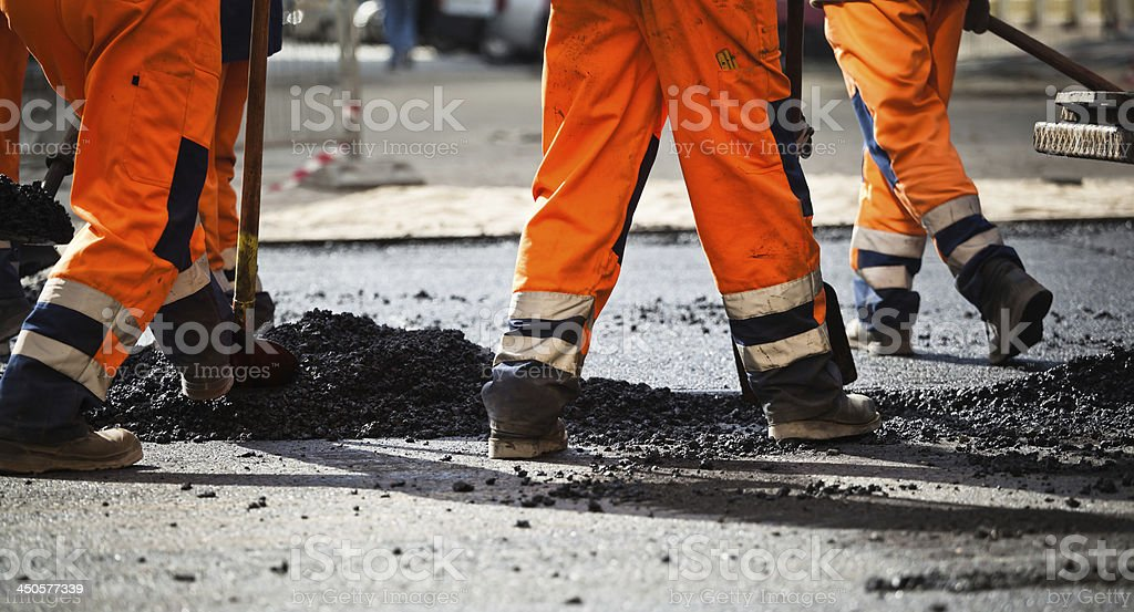 Road construction, teamwork stock photo