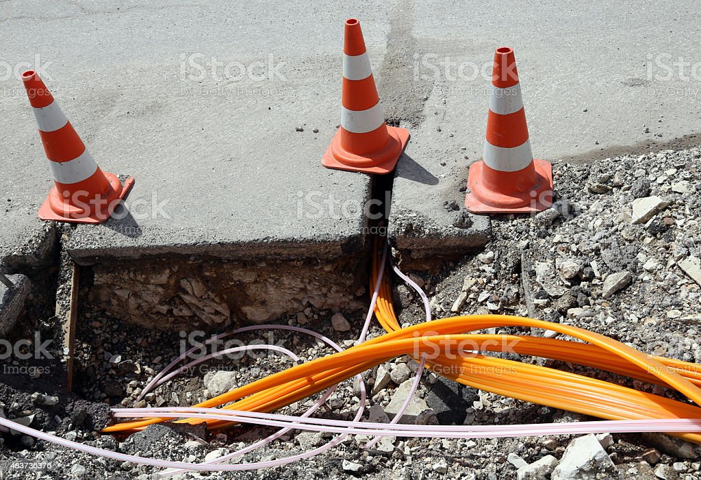 Road construction with pipes for laying optical fiber stock photo