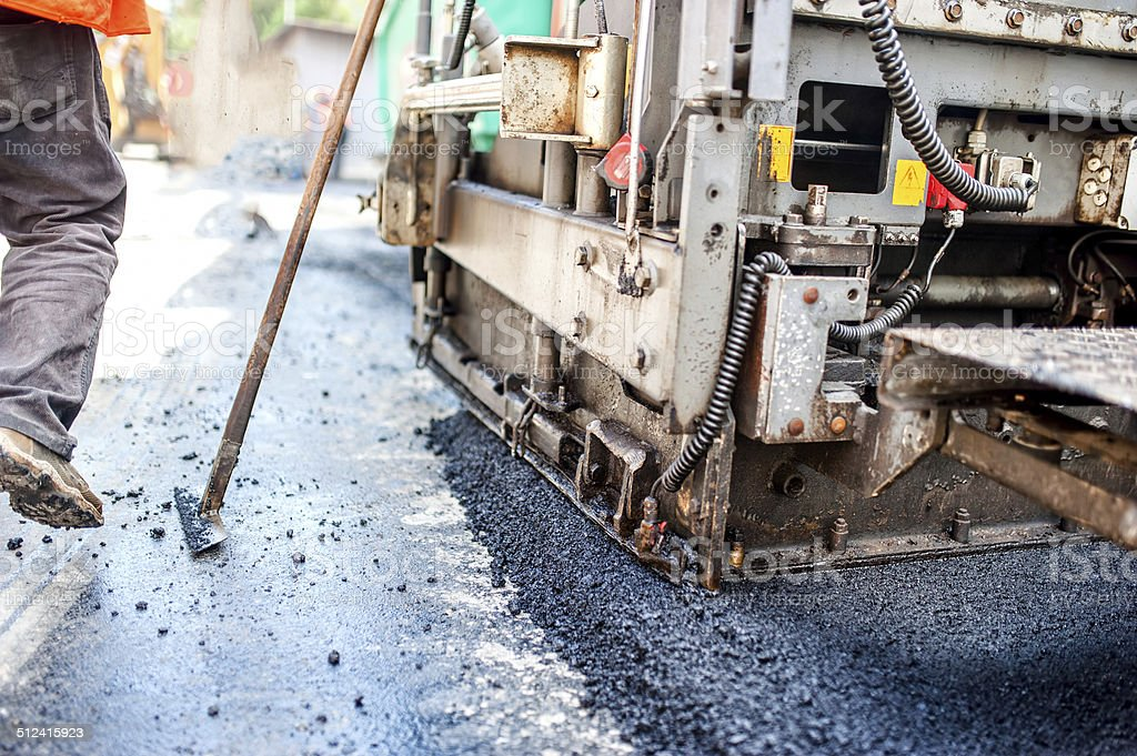 road construction with tools, workers and industrial machinery stock photo