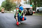 istock Road construction worker on job 1254049946