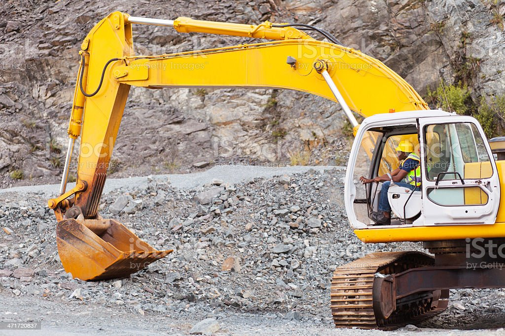 road construction worker operating excavator stock photo