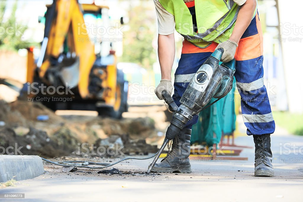 road construction worker with perforator stock photo