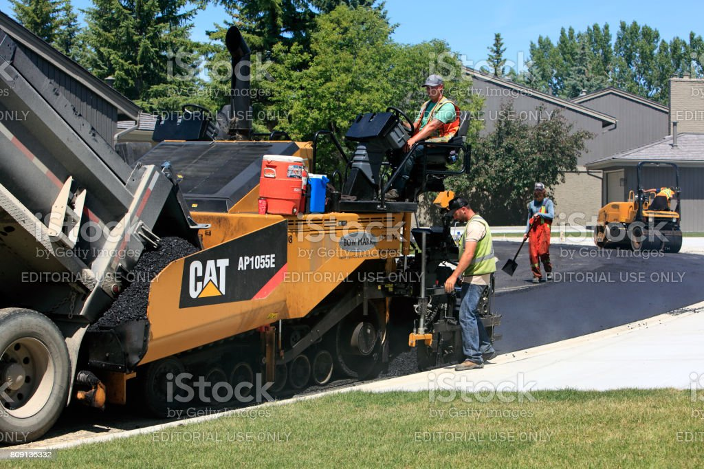 Road Crew And Equipment In Residential Area stock photo
