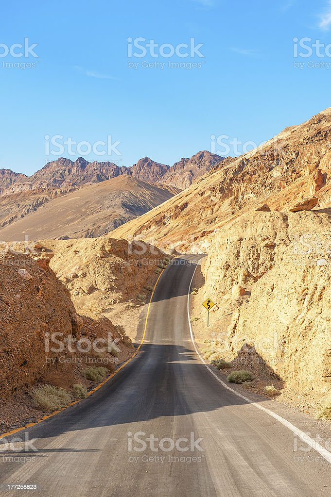 Road crossing Death Valley under the sun royalty-free stock photo