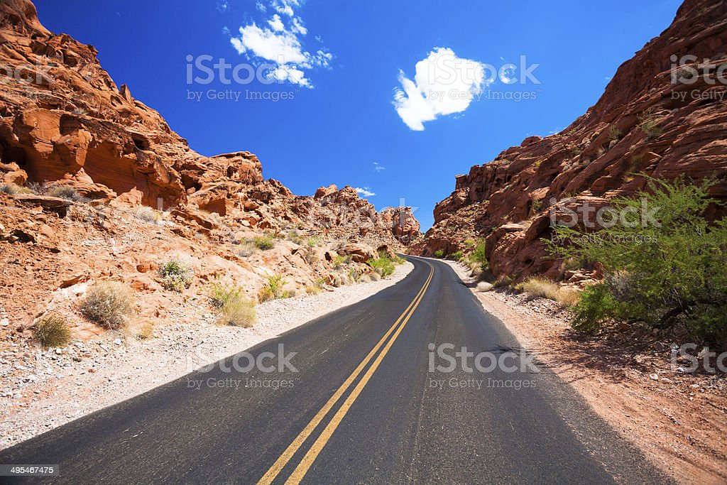 Road Crossing the Nevada Desert, Valley of Fire, USA stock photo