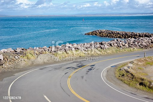 Breakwater made of rocks and boulders protects the low coastline in a small west coast town.