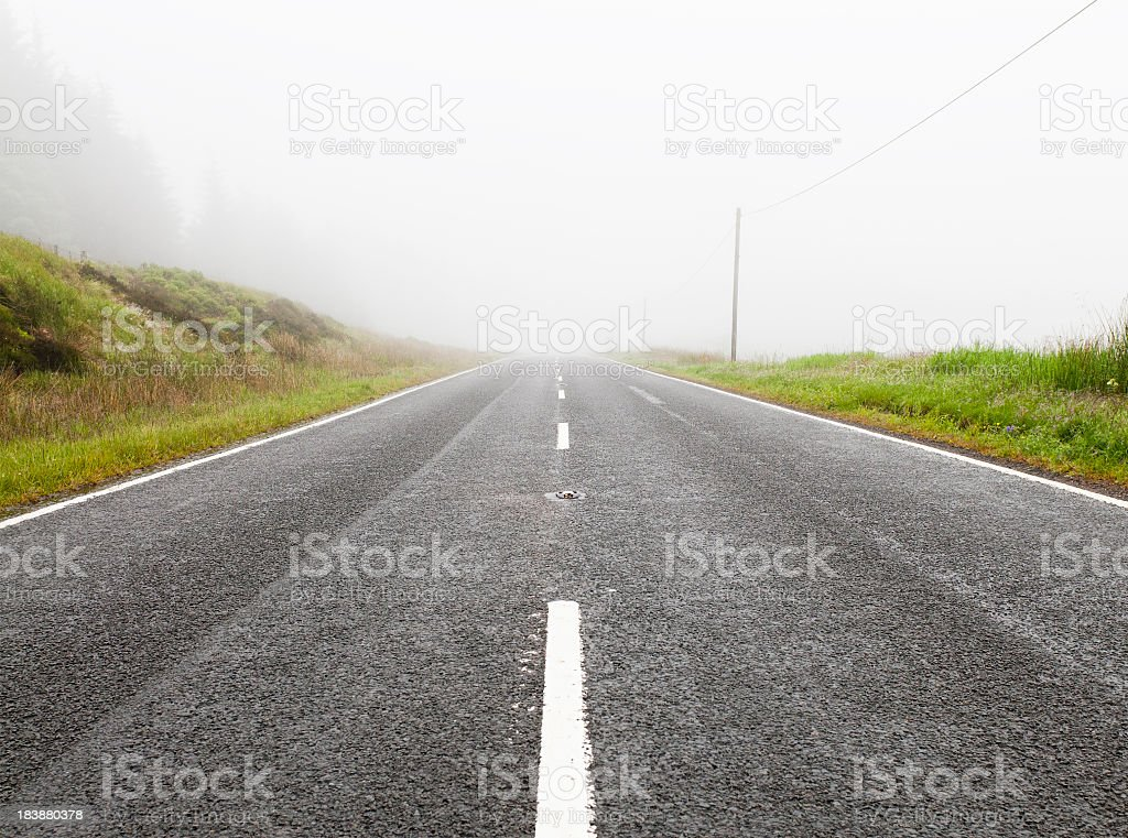 Road Disappearing Into Fog royalty-free stock photo