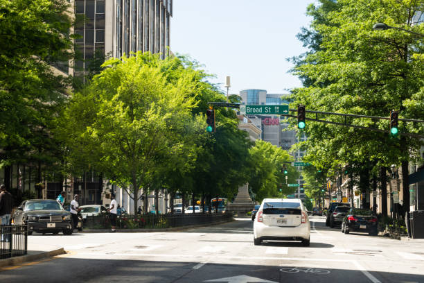 Road during day in downtown capital Georgia city with cars in traffic stock photo