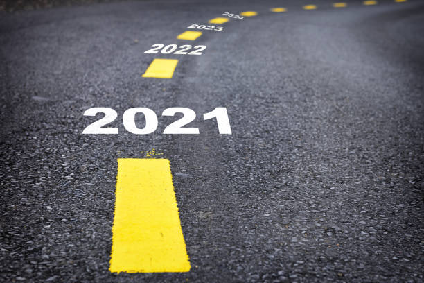 Road from 2021 to 2024 happy new year concept and natural background idea Number of 2021 to 2024 on asphalt road surface with marking lines the way forward stock pictures, royalty-free photos & images
