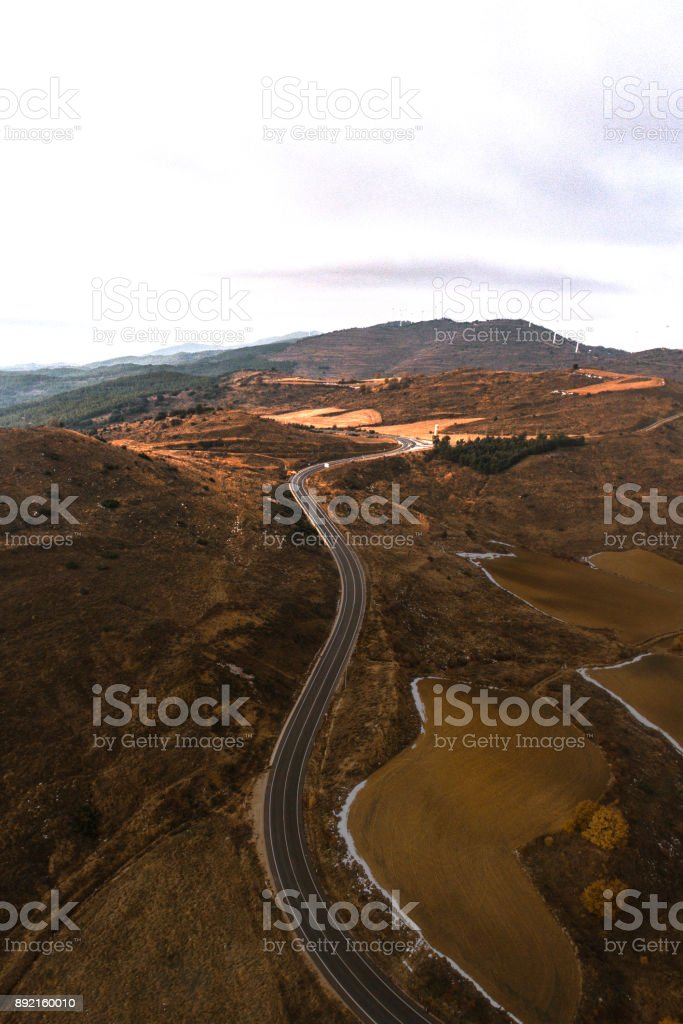 A road in a rural environment as seen from above.