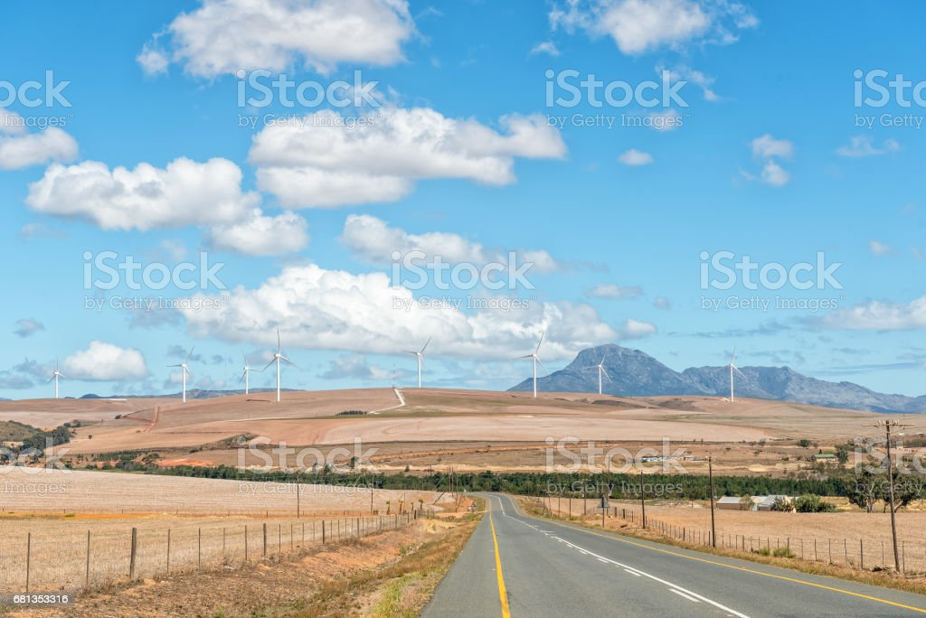 Road from Genadendal to Caledon with wind-farm in distance stock photo