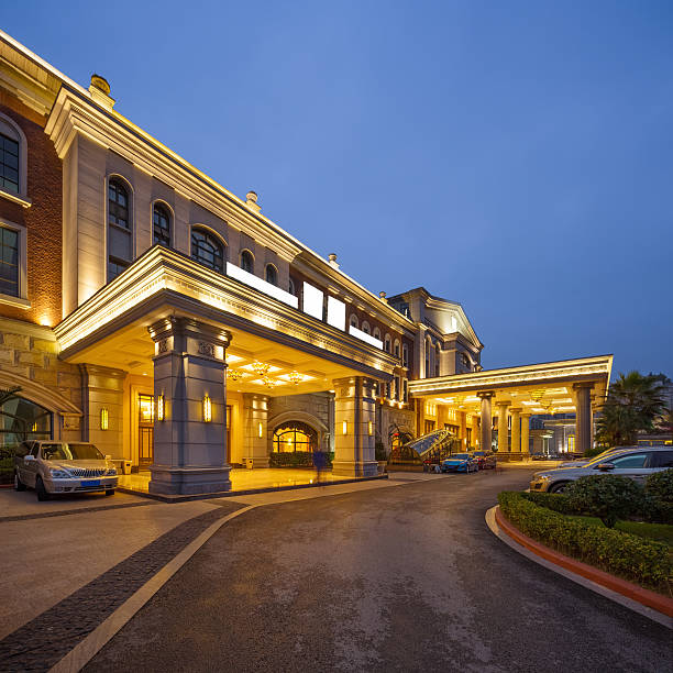 road front of luxury building in clear sky at night - building entrance stock photos and pictures