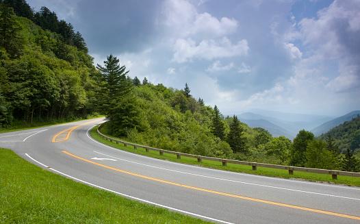istock A road going through the lush green mountains 182922729