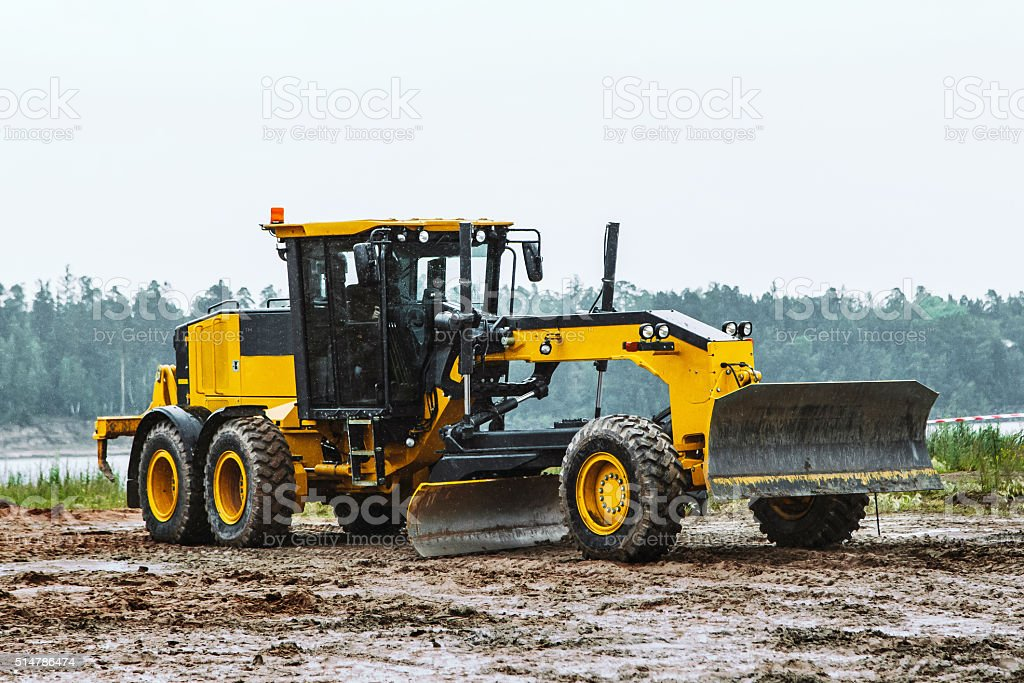 Road grader - heavy earth moving dirty stock photo
