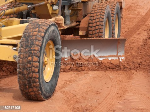 Road grader smoothing out the washboard on a dirt road.Construction photos here...