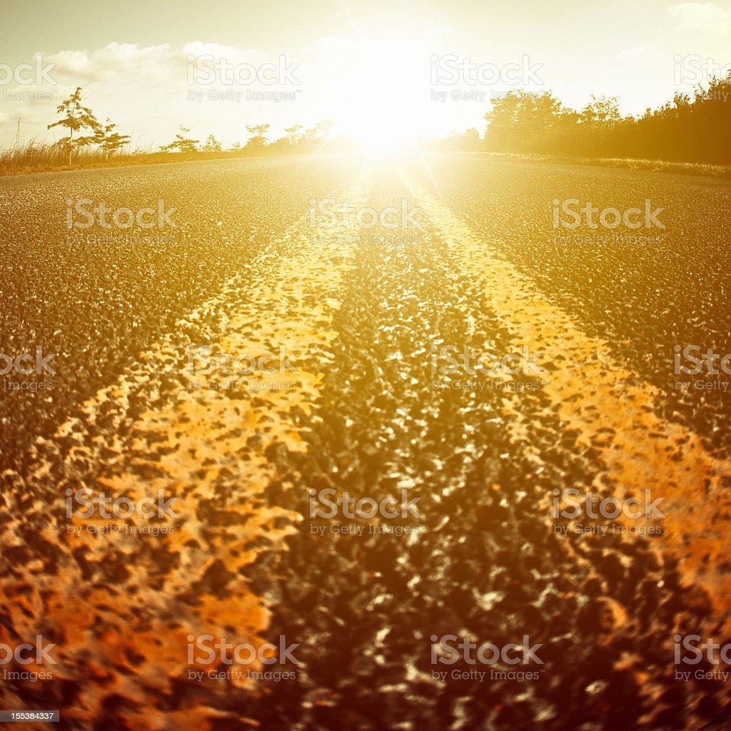 Road Heading The Horizon at Sunset royalty-free stock photo