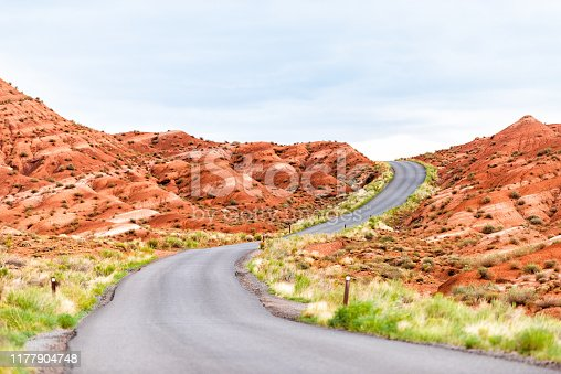 Road highway with nobody in Capitol Reef National Monument with winding paved street and colorful stone in Utah
