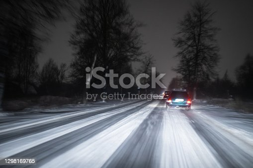 View from a moving car on a road in a snowstorm