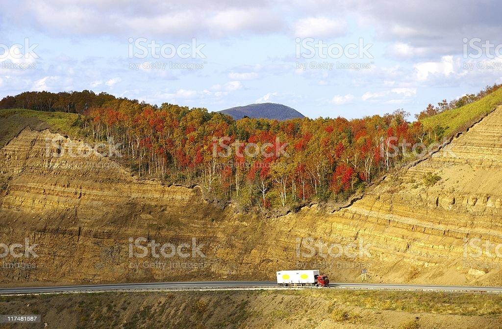 Road in autumn mountain stock photo