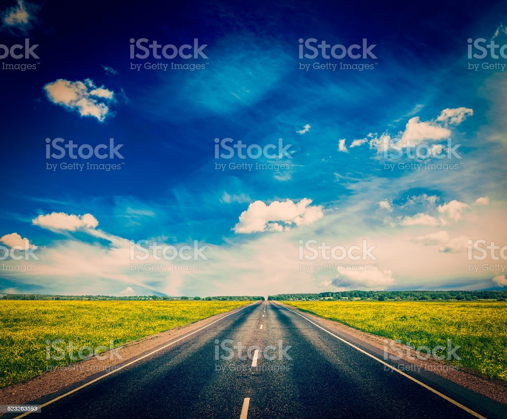 Road in blooming spring meadow stock photo