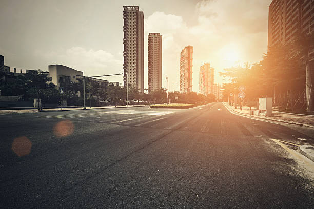 road in city with sunset - urban road stock photos and pictures
