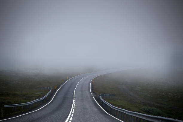 Road in fog (mist) Road in fog (mist). The picture was taken in Iceland in July 2017 skeptic stock pictures, royalty-free photos & images