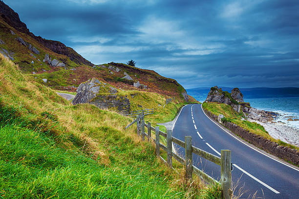 road in Ireland Highway in Ireland, location: Causeway Coast, County Antrim coastal feature stock pictures, royalty-free photos & images