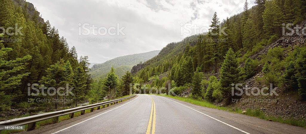 Road in Montana Rocky Mountains Panorama stock photo