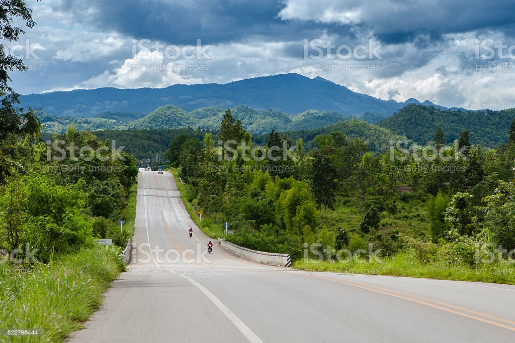 Road in mountain and blue sky background stock photo