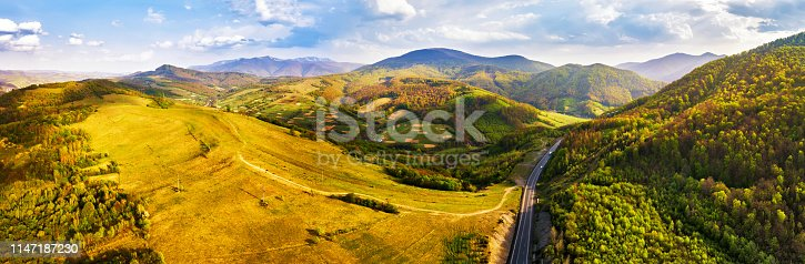 1042711480 istock photo Road in mountains. Evening sunlight on hills. 1147187230