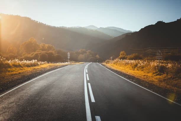 road in mountains. sunset. stock photo