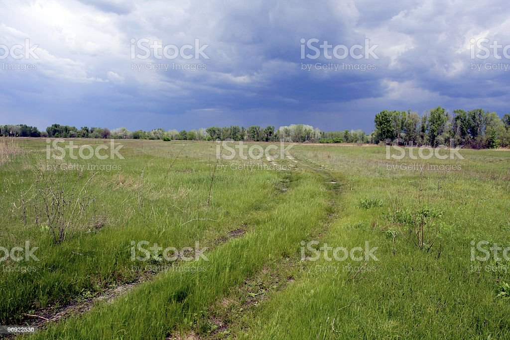 Road in steppe before thunderstorm royalty-free stock photo