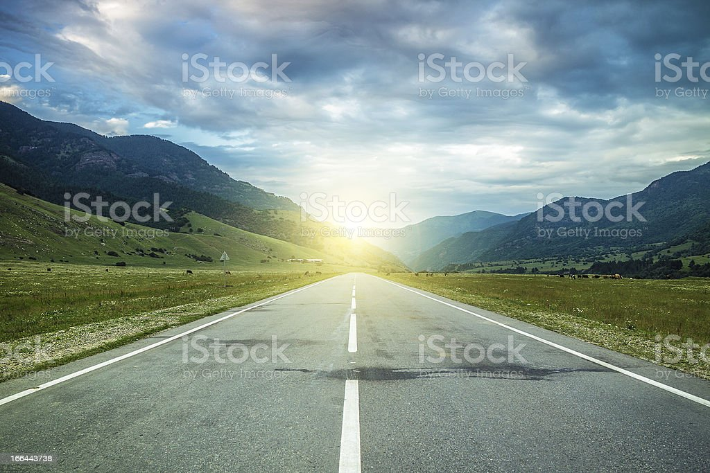 road in summer mountains to the sunset royalty-free stock photo