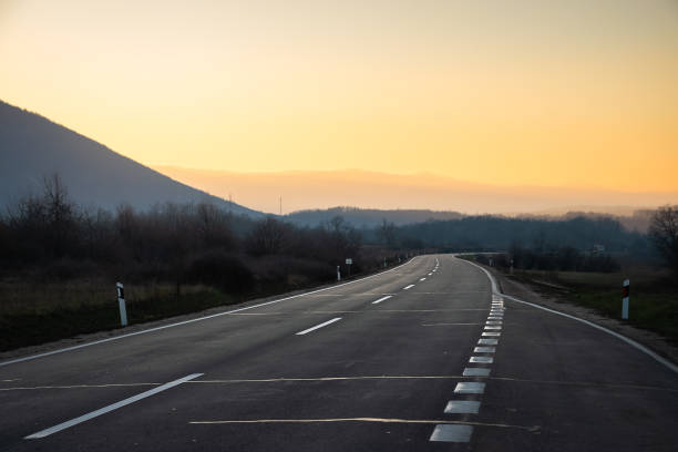 Road in sunset stock photo