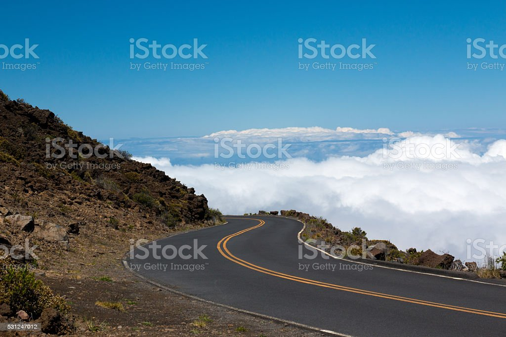 Road in the Clouds stock photo