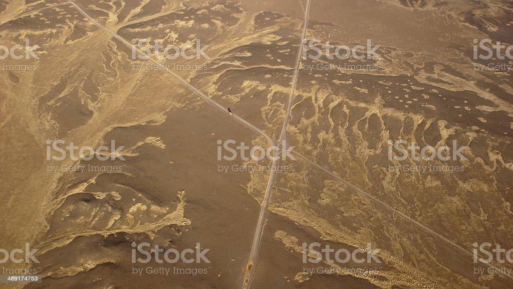 Road in the desert - aerial view stock photo