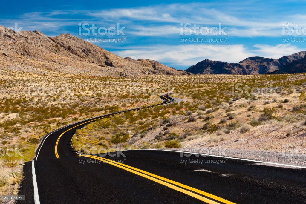 Road in the desert of Nevada, USA. stock photo