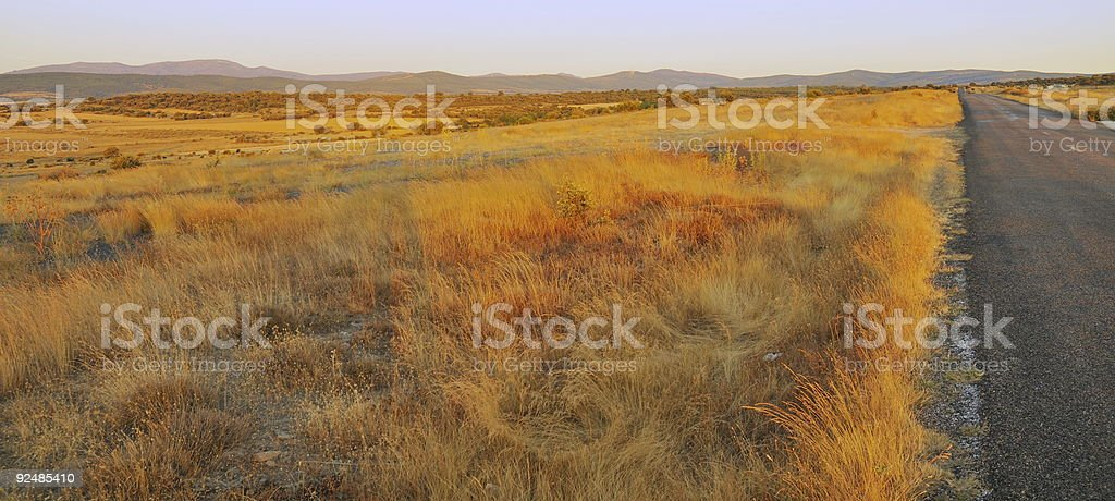 road in the dry prairie royalty-free stock photo