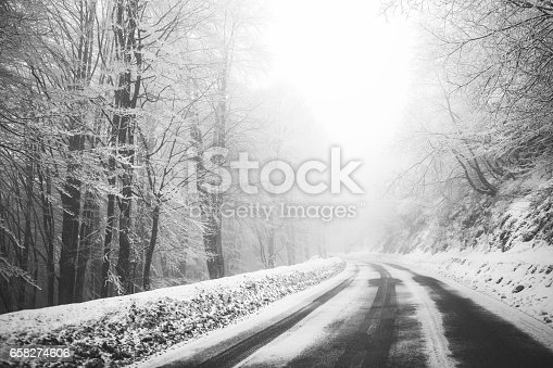 657042754 istock photo Road in the fog. Mysterious Way. Snowy mountain road. Risk of ice. 658274606