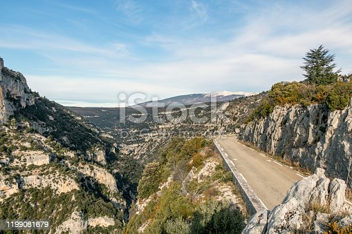 Stunning view with mountain landscape, cliffs and empty road going throw the Gorges de la Nesque spectacular canyon, which are part of UNESCO'S Mont Ventoux Biosphere Reserve, Provence, France, Europe