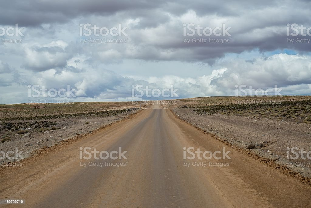 road in the middle of the bolivian altiplano stock photo
