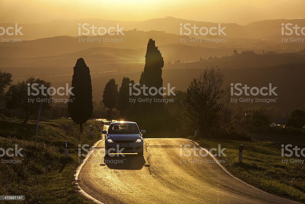Road in Tuscan Landscape at Sunset royalty-free stock photo