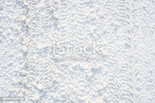 istock Road in winter, texture of snow and and traces of the tread 864900388