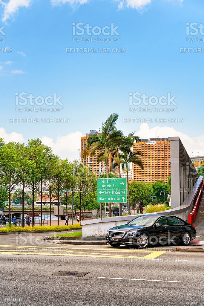 Road indicator New Bridge street and a car in Singapore stock photo