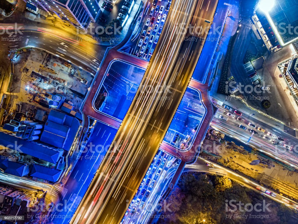 Road intersection at night stock photo