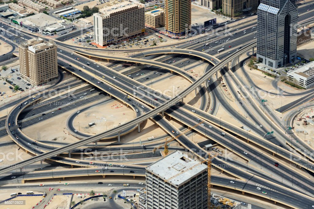 Road junction and skyscrapers from above in Dubai. stock photo