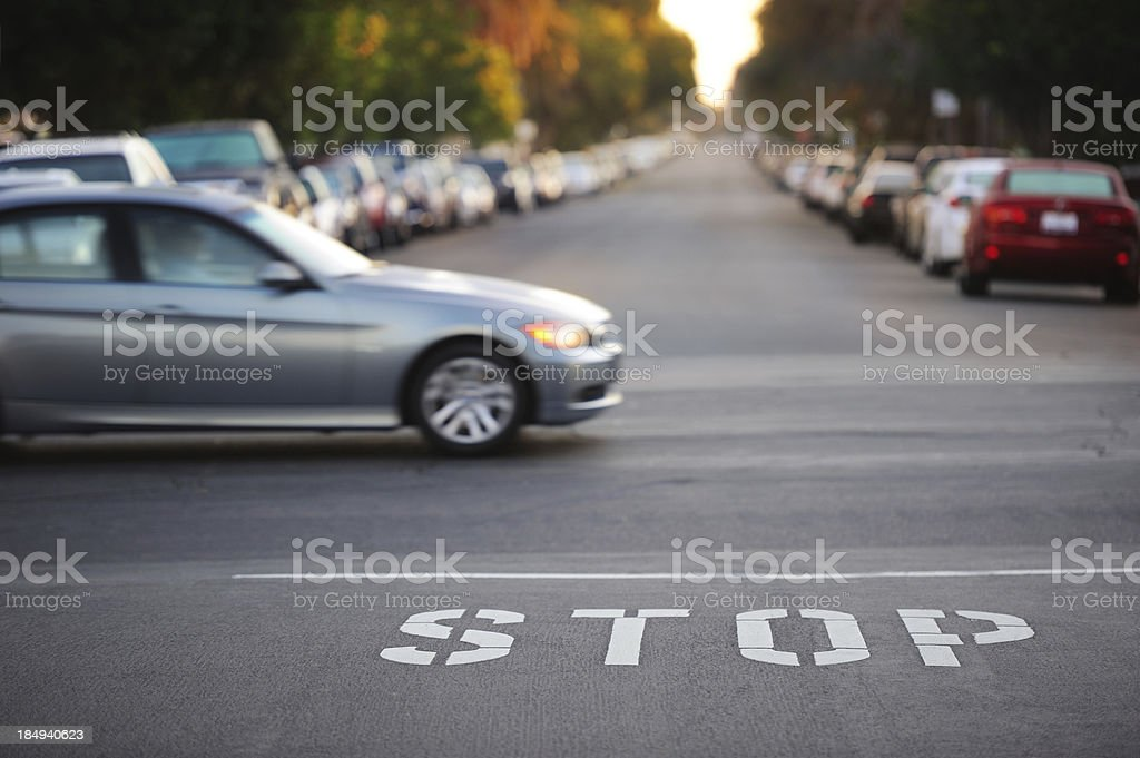 Road junction, stop word, motion blurred car stock photo